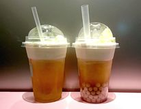 Bubble Tea. Heytea, Chinese Oolong milk tea with Cream cheese on top royalty free stock image