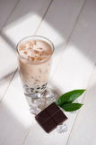 Bubble tea. Homemade Chocolate Milk Tea with Pearls on wooden ta. Ble stock image