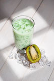 Bubble tea. Homemade Kiwi Milk Tea with Pearls on wooden table. Stock Photo