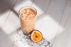 Bubble tea. Homemade Passion Fruit Milk Tea with Pearls on woode Royalty Free Stock Photos