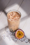 Bubble tea. Homemade Passion Fruit Milk Tea with Pearls on woode Stock Photography