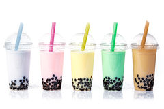 Bubble Tea in a row. Various Bubble Tea in a row isolated on white background royalty free stock image