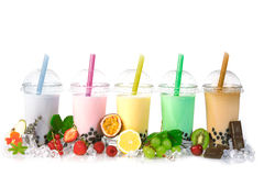 Bubble Tea in a row. Various Bubble Tea in a row isolated on white background with different fruits stock images