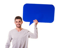 Bubble for text. Young beautiful man holding a blue bubble for text, isolated on a white background Stock Image