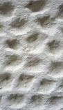Bubble texture on white cement wall finishing Royalty Free Stock Photo