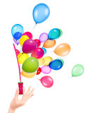 Bubble wand and flying balloons Stock Photos