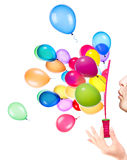 Bubble wand and flying balloons Royalty Free Stock Photos