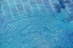 Bubble from water treatment in swimming pool. Bubble from water treatment in blue swimming pool royalty free stock image
