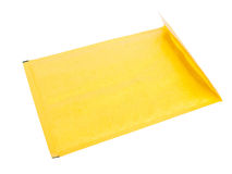 Bubble wrap envelope. Yellow bubble wrap envelope isolated over white, studio shot royalty free stock photography
