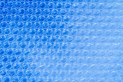 Bubble wrap. Is a pliable transparent plastic material commonly used for packing fragile items. Regularly spaced, protruding air-filled hemispheres (bubbles) royalty free stock photography