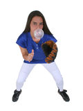 Bubblegum Softball Player. Beautiful teen girl playing softball on white background with giant bubblegum bubble in mouth stock photo