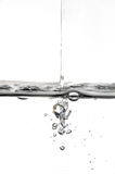 Bubblejet. Drops falling into a bowl of water Stock Image