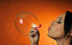 Bubbles. Attracive young woman having fun blowing some bubbles Royalty Free Stock Photos