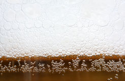 Bubbles. On the top of the beer Royalty Free Stock Images