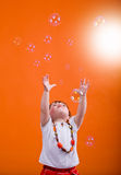 Bubbles. A little girl hunting soap bubbles Royalty Free Stock Image