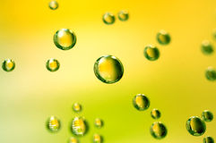 Bubbles. With smooth green and yellow background Royalty Free Stock Photos