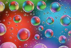 Bubbles. Colorful water bubbles lying on the glass(macro royalty free stock images