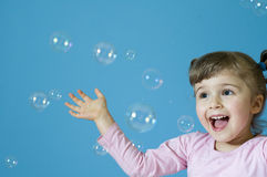 Bubbles. Little girl playing with bubbles stock photos