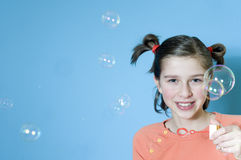 Bubbles. Teens girl playing with bubbles Stock Photo