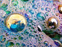 Bubbles. Soap bubbles on a water surface Royalty Free Stock Image