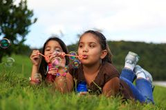 Bubbles. Two girls playing with bubbles Stock Photo