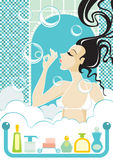 Bubbles. The girl in a bath starts up bubbles Stock Photography