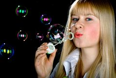 Bubbles. The girl inflates soap bubbles Stock Image