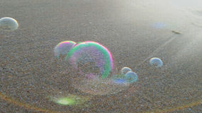 Bubbles on the beach Stock Photography