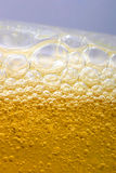 Bubbles in beer. Or dishes soap shampoo close-up Stock Images