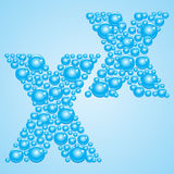 Bubbles in blue. Alphabet of bubbles. Eps 10. Bubbles in blue on a light blue background Royalty Free Stock Photography