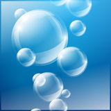 Bubbles on blue background Royalty Free Stock Images
