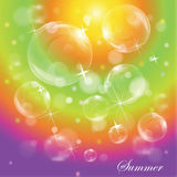 Bubbles on bright colorful rainbow background Stock Photo