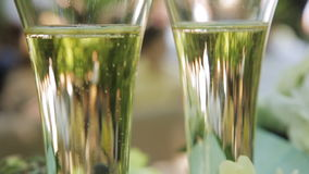 Bubbles of champagne in wedding glasses. Two glasses of champagne celebration or date stock footage