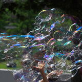 Bubbles. Children having fun with soap bubbles royalty free stock image
