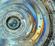 Bubbles in drink. Mineral water on bottom of glass royalty free stock image