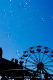 Bubbles and ferris wheel Royalty Free Stock Image