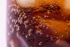 Bubbles and fizz. A cool glass of cola drink with ice Royalty Free Stock Images