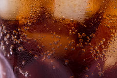 Bubbles and fizz. A cool glass of cola drink with ice Stock Image