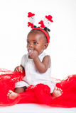 Bubbles flating. A 8 month old baby dressed to explore Christmas Stock Photography