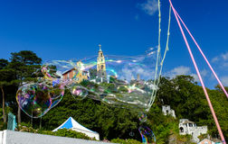 Bubbles float in front of 'The Campanile' bell tower Stock Images