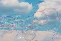 Bubbles floating on the breeze in the sky Royalty Free Stock Image