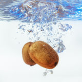 Bubbles forming in blue water after kiwi Stock Photography
