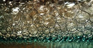 Bubbles. Macro of bubbles in micellar cleansing water Royalty Free Stock Photo