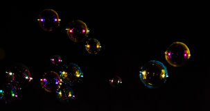 Bubbles. A number of multi coloured bubble set against a black background royalty free stock photo