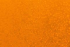 Bubbles. On orange background macro photo Royalty Free Stock Images