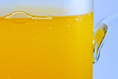 Bubbles in an orange drink closeup Royalty Free Stock Images