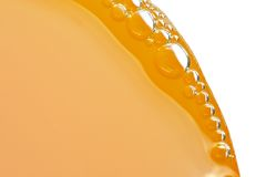 Bubbles of orange juice Royalty Free Stock Photo