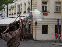 Bubbles in Prague. Artist is making bubbles for kids Royalty Free Stock Photos