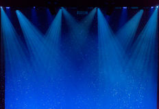 Bubbles and rays of blue light through the smoke on stage. During theatrical performances Stock Image