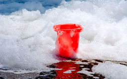 Bubbles and red bucket Stock Photography